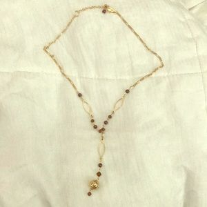 Gold necklace with brown rhinestones